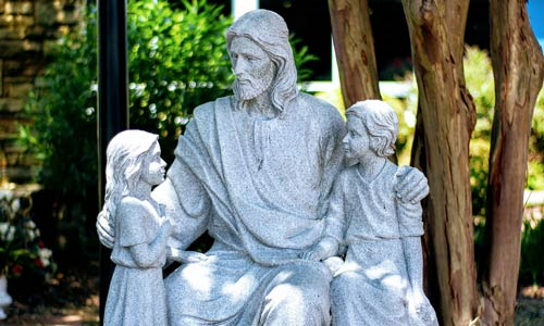 Statue of Jesus with children