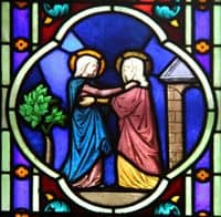 Stained Glass Window depiction of the Visitation, Mary visiting Elizabeth.