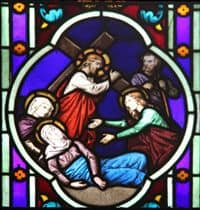 Stained Glass Window depiction of Jesus carrying His Cross.