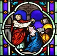 Stained Glass Window depiction of Mary and Joseph's presentation of Jesus in the Temple.