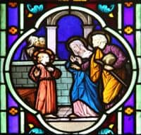 Stained Glass Window depiction of Jesus being found by Mary and Joseph in the Temple.