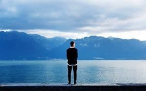Man looking across the sea