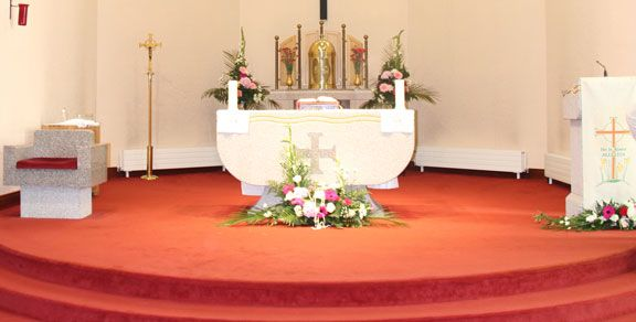 Inside a Catholic Church showing Altar in preparation for Holy Mass.