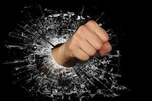 Fist protruding through broken window