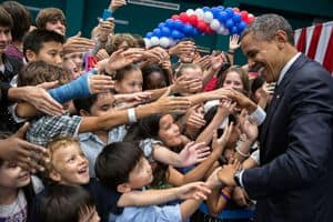 Barack Obama shaking hands with children