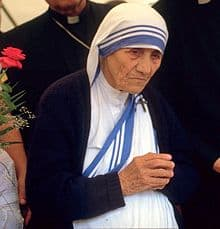 St Mother Teresa in her traditional white with blue edge clothing.