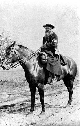 Photograph of Daniel Brottier on horseback
