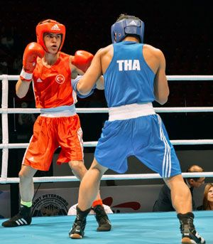 Two Thai boxers in ring
