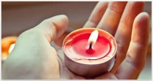 Lit Candle in Hand