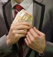 Man putting money into coat pocket