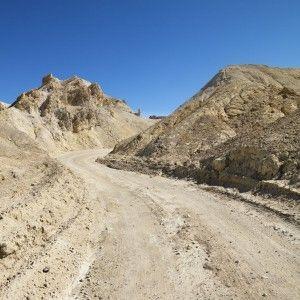 Dir- winding road on hillside