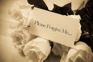 "Flowers with note saying, ""Please forgive me"""