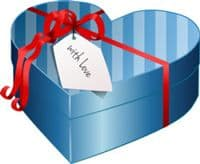"Heart shaped gift box tied with red ribbon and labelled ""With Love""."