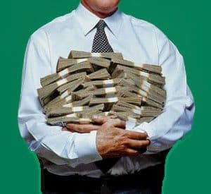 Man with armful of money