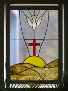 Stain-glass window image of Holy Spirit