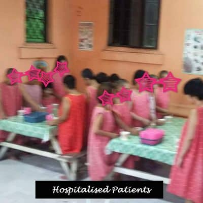 Hospitalised patients preparing to eat.