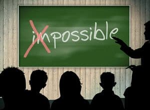 """Im"" of the word impossible X-ed out"