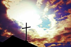 Cross against sky background