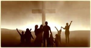 Celebrating beside Cross