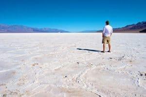 Man looking across a salt plain