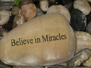 Stone with sign - Believe in Miracles