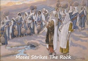 Moses strikes the rock and water flows