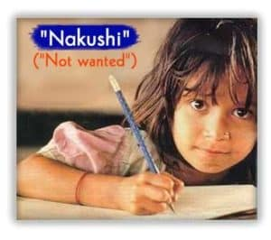 Smiling Indian girl writing with a pencil.