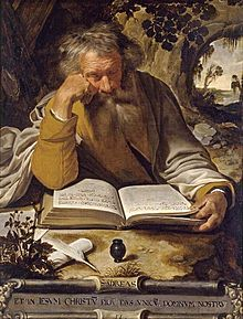 Image of St Andrew the Apostle sitting reading