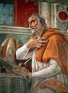 Image of St Augustine of Hippo kneeling in prayer
