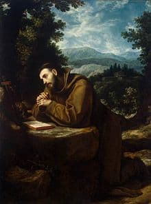 Image of St Francis of Assisi kneeling in prayer
