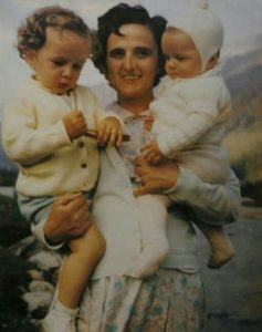 Image of St Gianna with two children in her arms