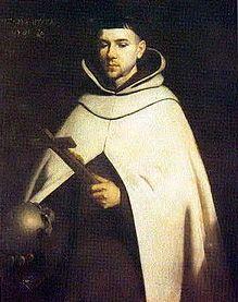 Image of St John holding a Cross