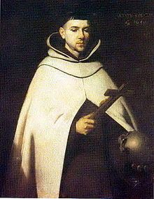 Image of St John of the Cross holding a wooden Cross.