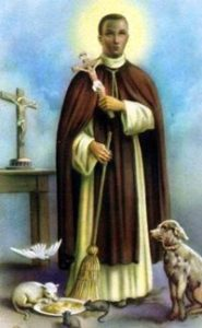 St Martin de Porres holding a Cross and surrounded by animals.