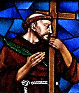 Stain glass window picture of St Nikola Tavelic holding a Cross.