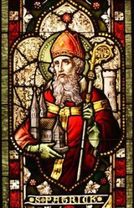 Stain-glass image of St Patrick holding a Bishop's Staff.