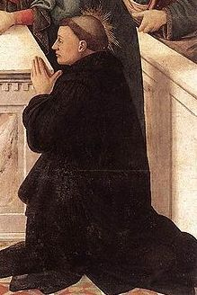 Image of St Peregrine kneeling in prayer.