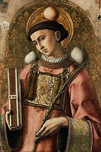 St Stephen the Deacon holding a Bible.