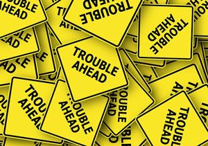 """Signs: """"Trouble Ahead"""""""