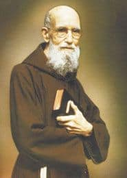 Image of Solanus Casey holding a Bible.