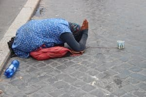 Woman beggar on the streets of Rome