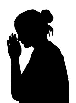 Silhouette of Woman Praying