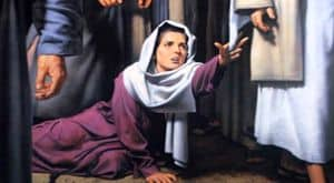 Woman attempting to touch Jesus' cloak