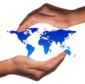 Map of world between two hands