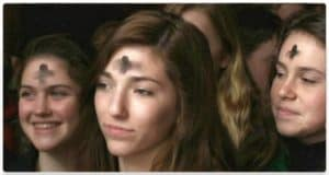 People with ashes on forehead