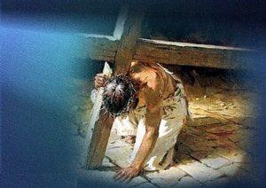 Jesus kneeling under the weight of His Cross