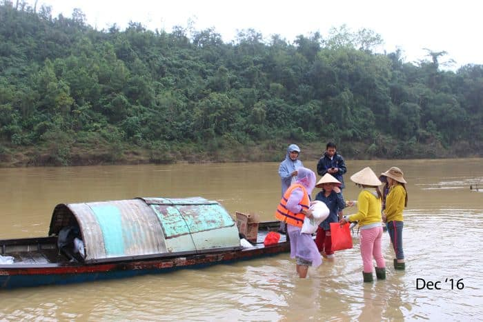 Volunteers carrying Food Parcels to river boat